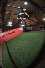 Gage Boyle with the fakie flip over the turf.