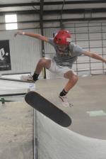 Kendra Long kickflipping into a rock fakie.