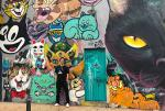 Dylan is more of a dog person but this cat wall was too cool not to stop for a photo.