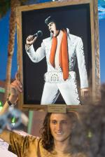 Evan Smith won it and goes home with this Elvis velvet painting, among other things.