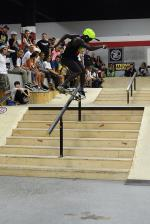 Zion Wright with a backside 270 lipslide down the handrail.