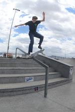 Nicolas Michel with a bluntslide down the rail.