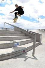 Taylor Willis with a kickflip front board down the rail.