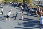 Yuri Santos doing a kickflip backlip down the rail.