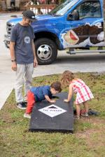 Corn Hole keeps The Boardr Babies Alvis and Sloane busy. Photo: James Luedde