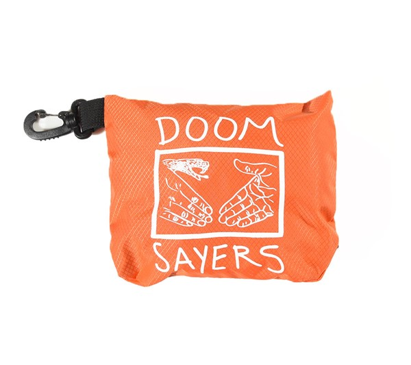 Doom Sayers Packable Travel Bag Black, Orange Folded Up.